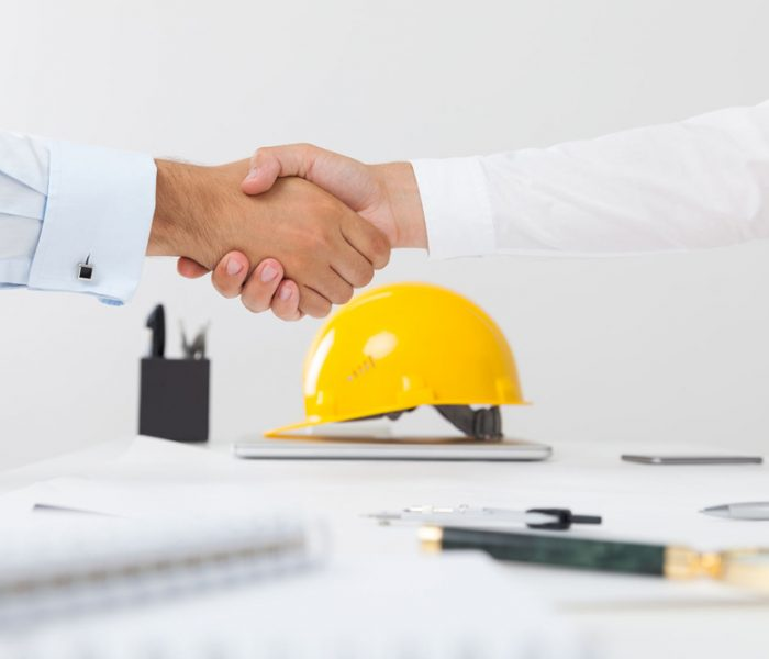 61820491 - contractor and company executive sealing a deal shaking hands. concept of new job opportunities and city development